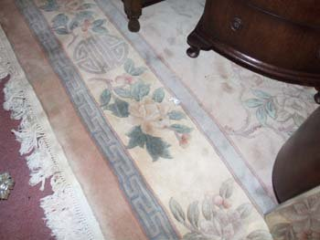 1D: A hand knotted Chinese carpet the camel coloured fi