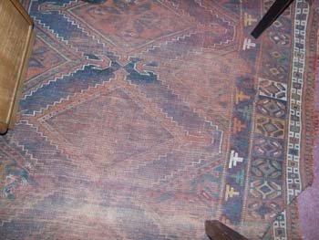3D: A Hamadan rug the red field with geometric motifs a
