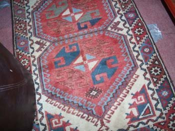 5D: A hand knotted Hamadan rug the red ground with repe