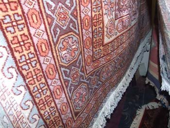 22D: A hand knotted Persian Kazak carpet the camel fiel