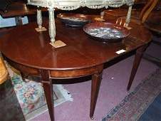 389D: A Georgian mahogany 'D' end dining table with two