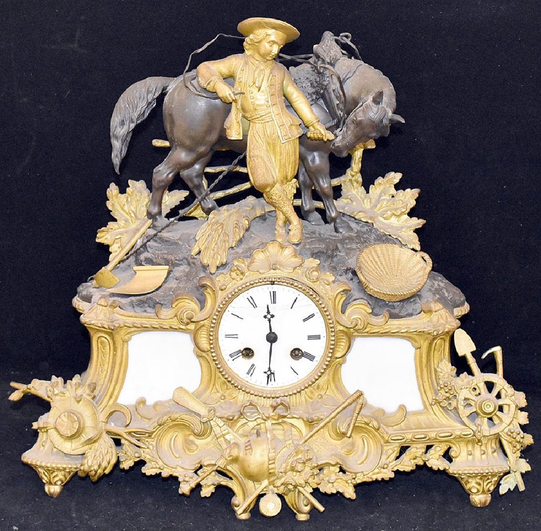 French Gilt and Patinated Bronze Mantle Clock
