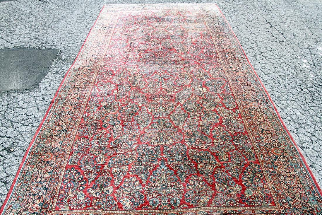 "Sarouk Room-Size Carpet, 22' x 10'2""."