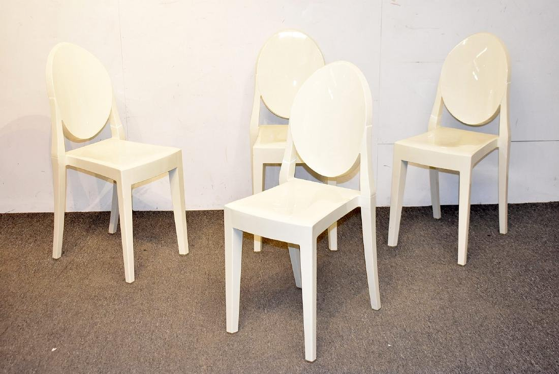 Four Philippe Starck-Style Stacking Side Chairs