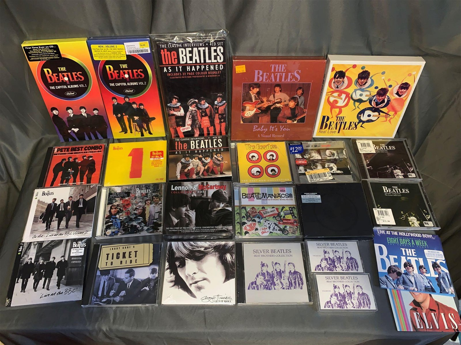 24 Beatles CDs and Cassettes