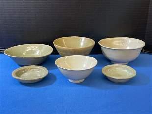 Six Celadon and Glazed Earthenware Bowls