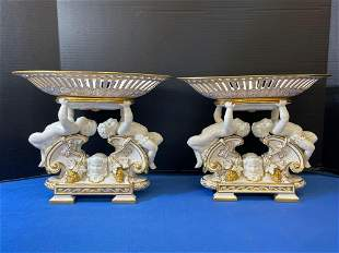 Pair of Continental Porcelain Cherub Compotes