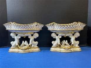 Pair of Continental Porcelain Cherub Urns