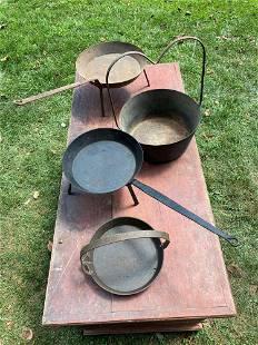 Four Wrought Iron Pans