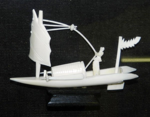 174: Framed Antique Carved Ivory Boat