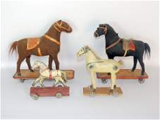 Four Antique Horse Pull Toys