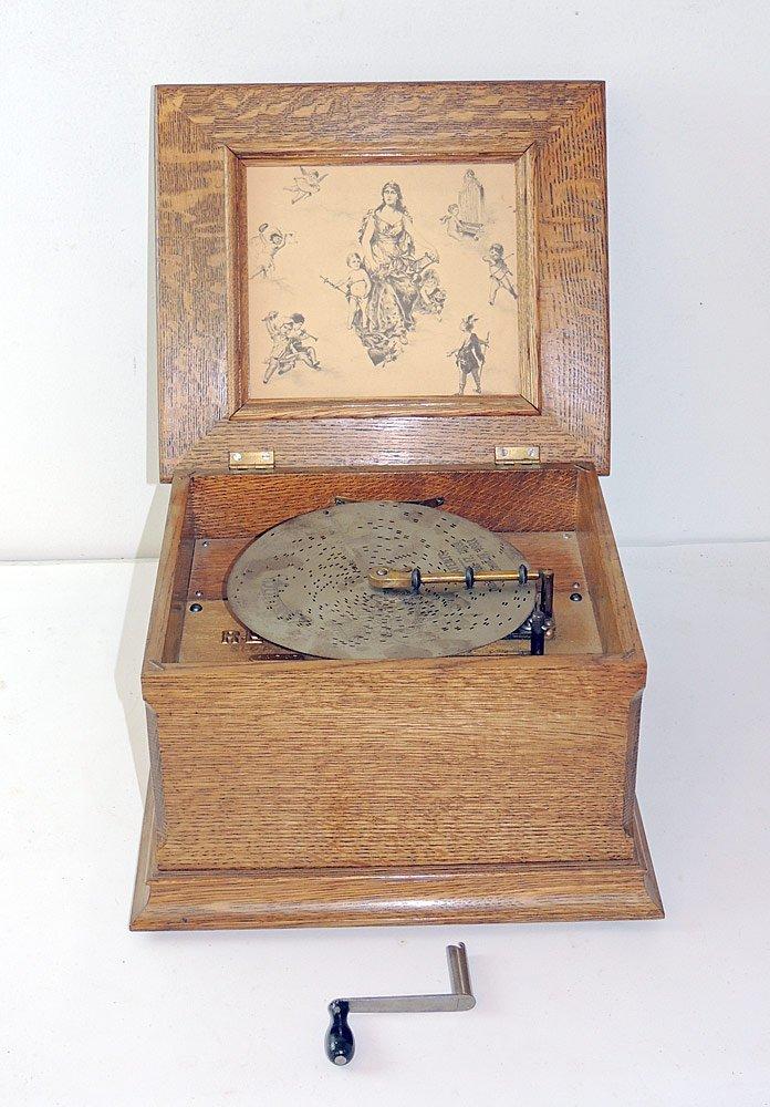 Regina Tabletop Disc Music Box in Oak Case