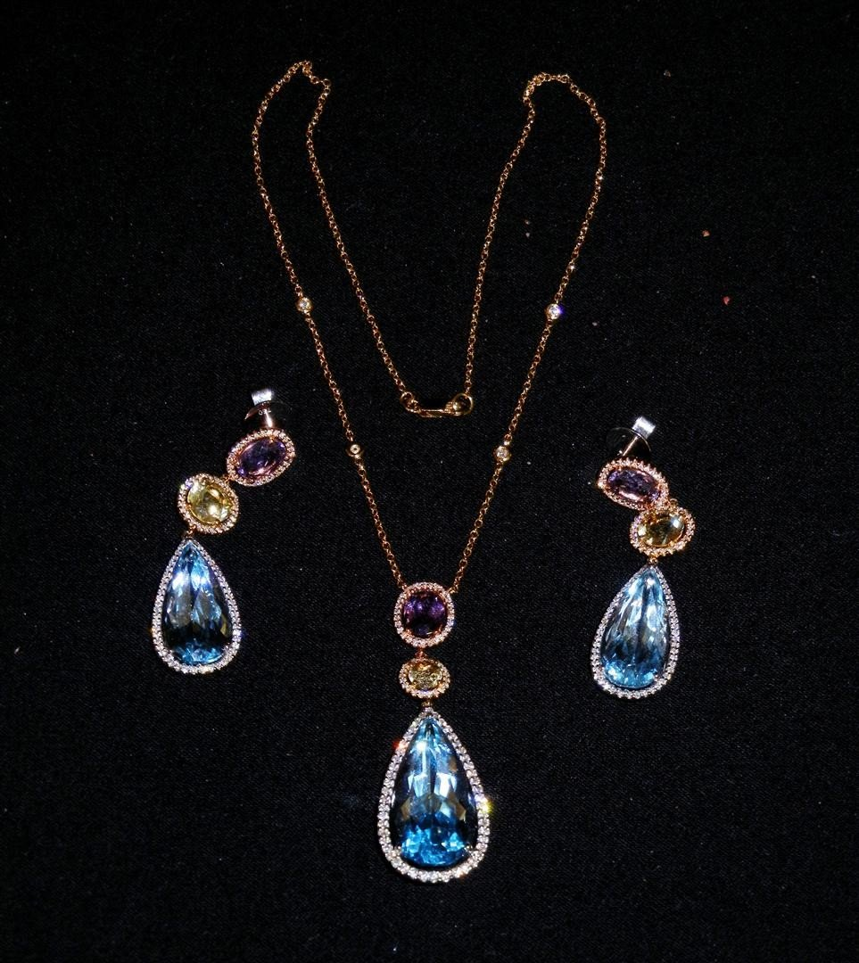 100: 18KG Gemstone Necklace & Earring Suite