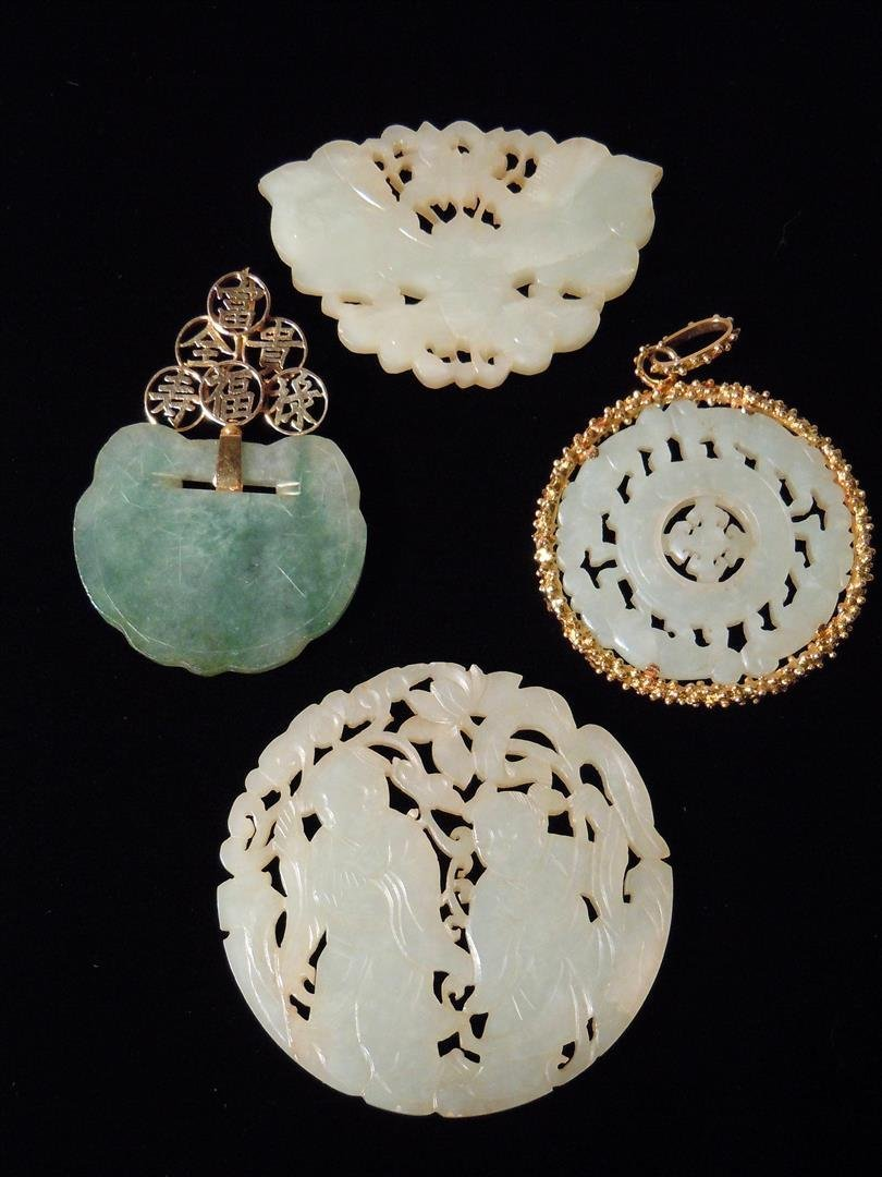 Two Jade Plaques in Gold Bezels and Two Others