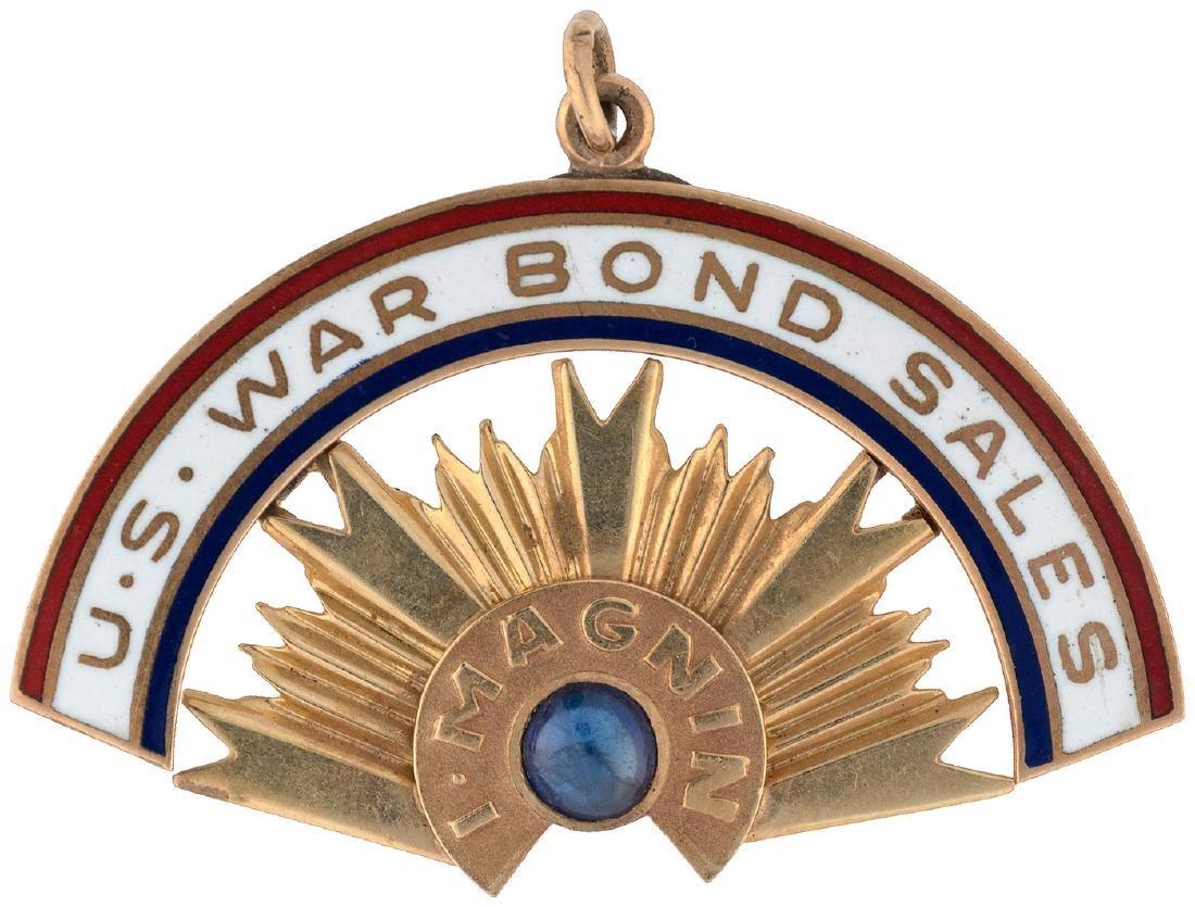 "14K GOLD AND ENAMEL PENDANT ""U.S. WAR BOND SALES/I. MAGNIN""."
