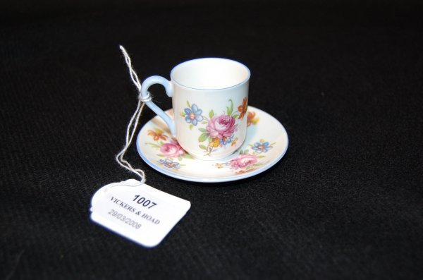 1007: Miniature Shelley  cup and saucer with floral pat