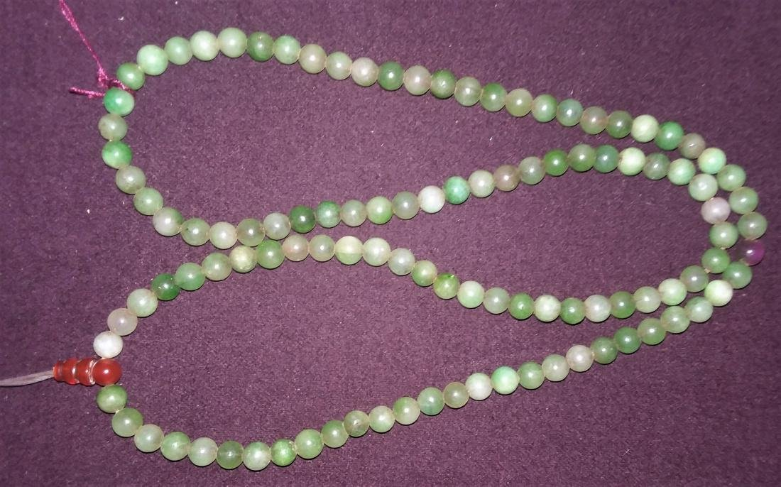 A FAR EASTERN CARVED JADE AND MULTI STONE NECKLACE, - 3