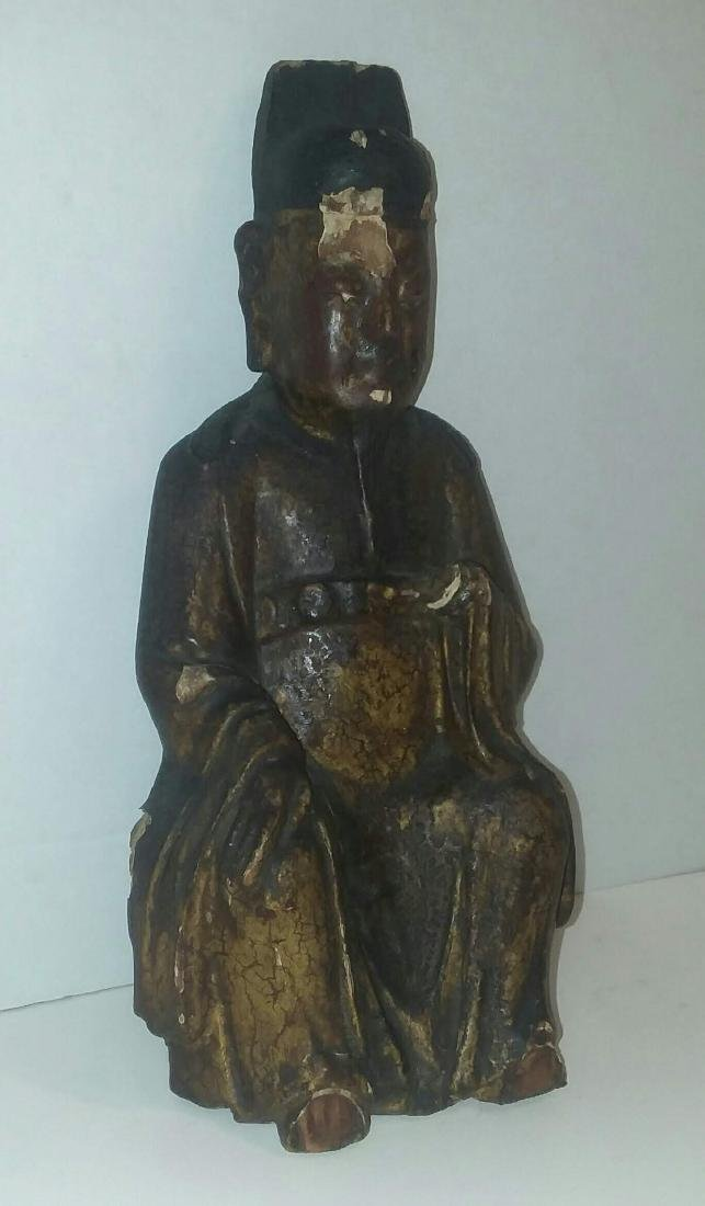 EARLY MING DYNASTY LACQUERED GILT FIGURE