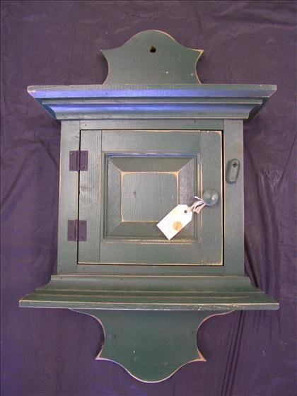 5007: Green wood whale tail wall cabinet