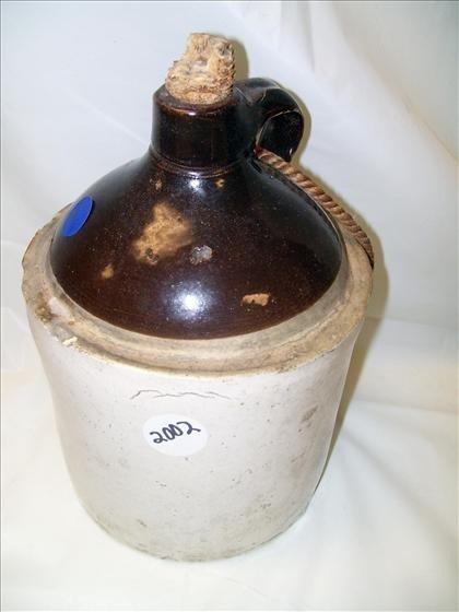 2002: Stoneware jug unmarked corn cob stopper