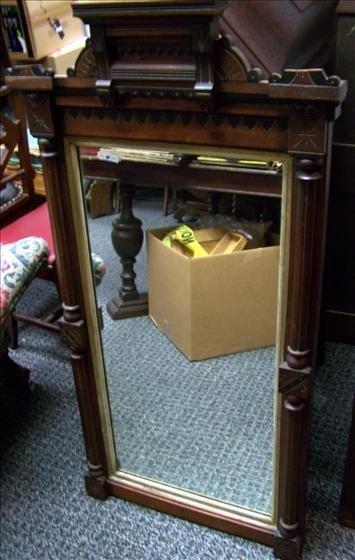 5023: Large Eastlake hand carved mirror
