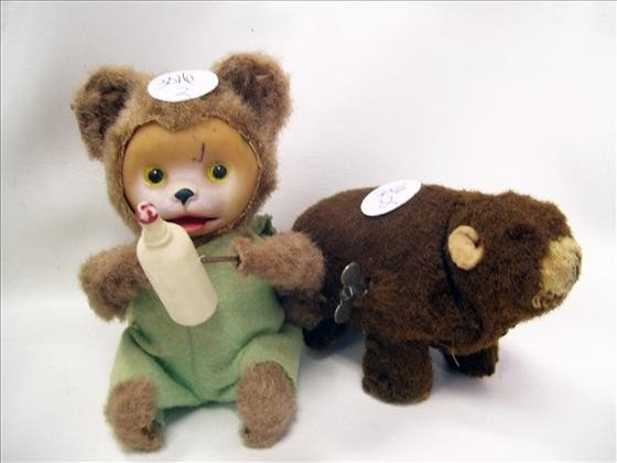 3016: 2 wind up bears - one with bottle