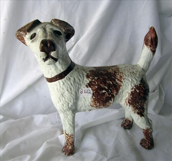 3022: Brown and white dog door stop