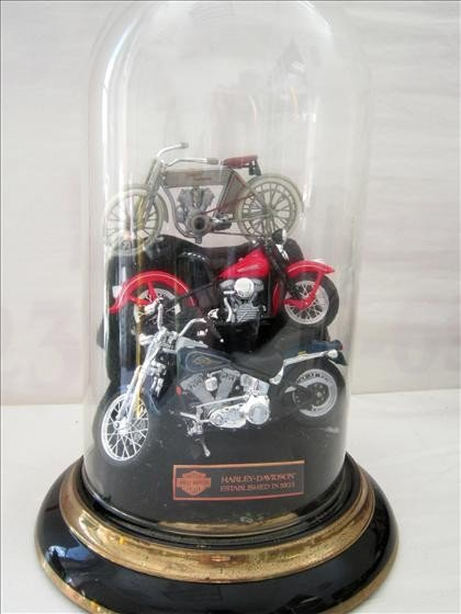 7018: 3 plastic Harley bikes in a glass dome