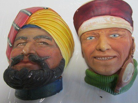 4021: 2 Character heads made in England