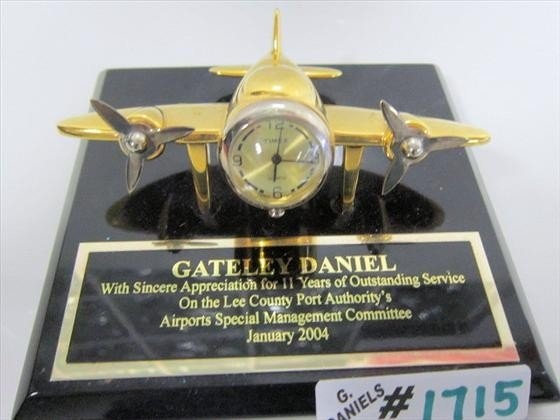 1715: Airplane clock on plaque