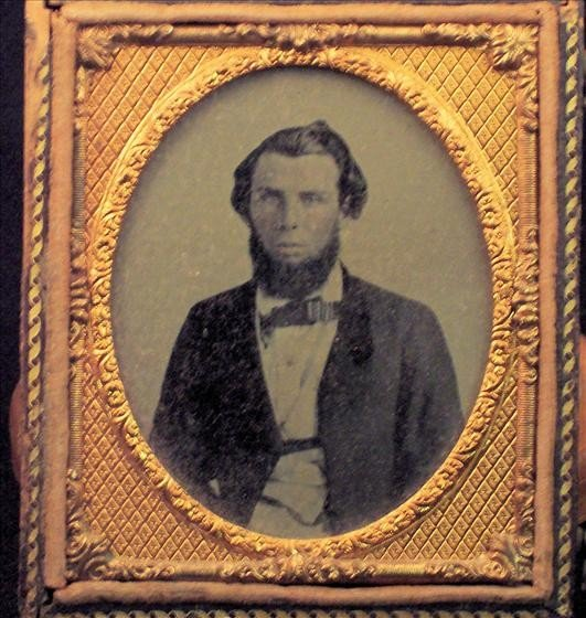 8004: Tin Type photo of man in his Sunday best.
