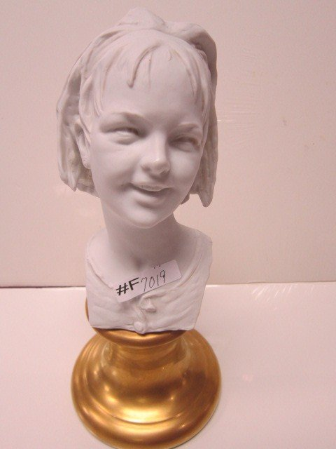 7019: Porcelain bust of girl on gold tone base