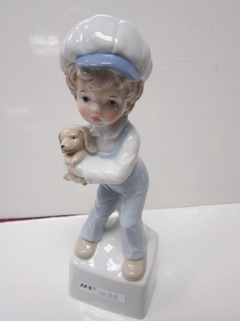 7022: Porcelain boy figurine with puppy