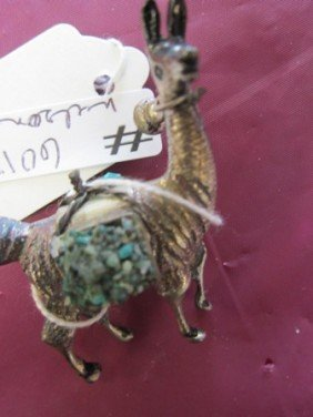 6013: Silver plated?- Lama with green stones