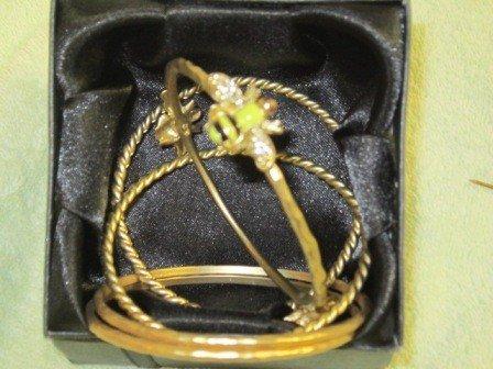 8021: 5 gold tone solid bracelets