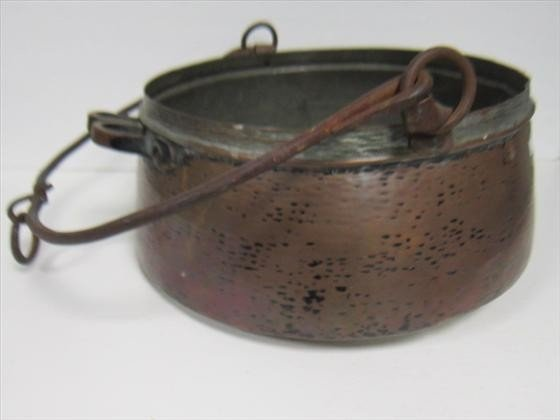 1765: Hand hammered copper kettle