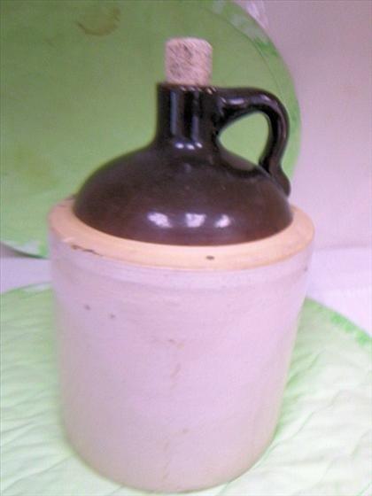 8022: Stoneware jug with cork brown and tan