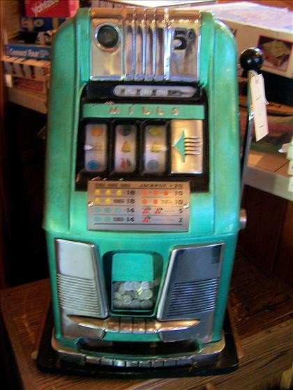 157: Antique Mills one arm bandit slot machine
