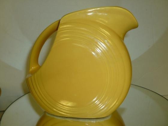 "1821: Fiesta ware pitcher in yellow-5 1/2""h"