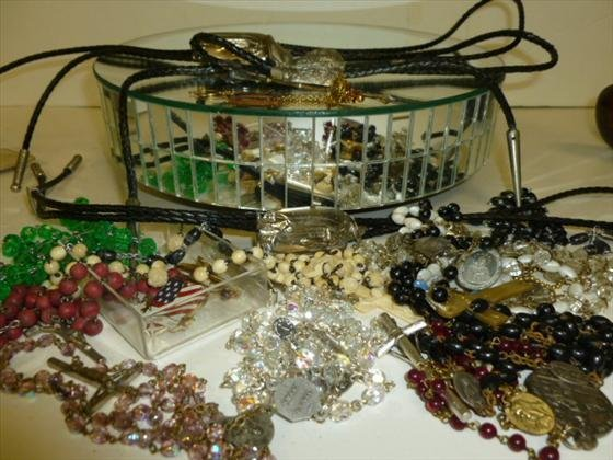 1838: Assorted lot jewelry-Bolo ties,rosary beads…