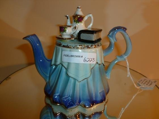 Royal Albert tea pot with tea pot and book top