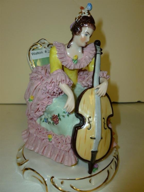 Dresden figurine-lady playing cello