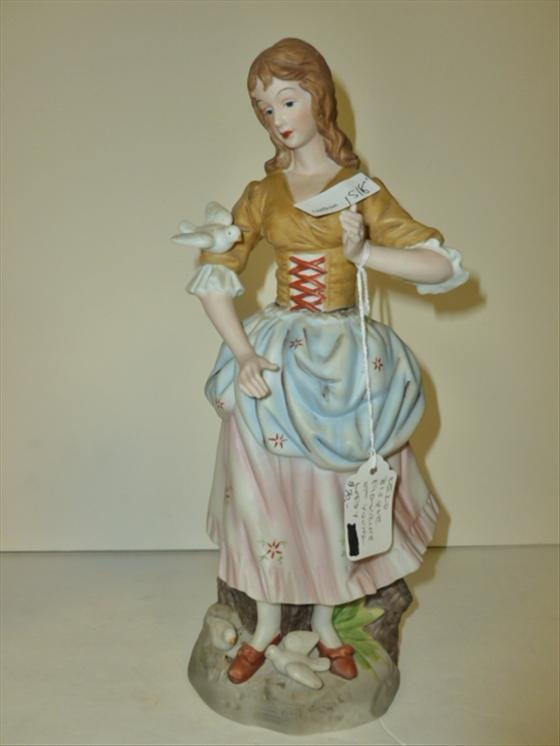 Bisque lady figurine with doves
