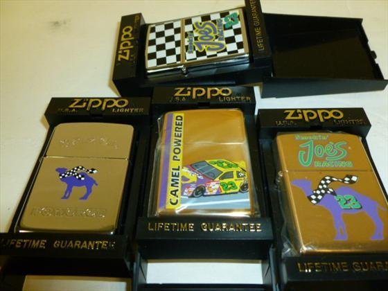 4 Zippo lighters in plastic cases Joe's Camel