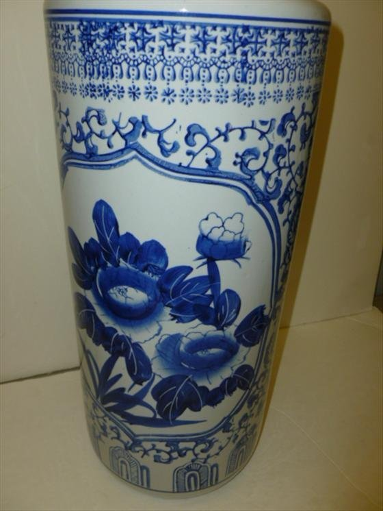 Blue and white umbrella or cane stand