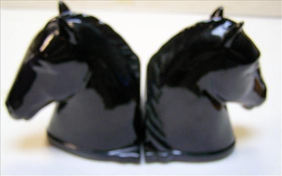 Set of black porcelain horse head bookends