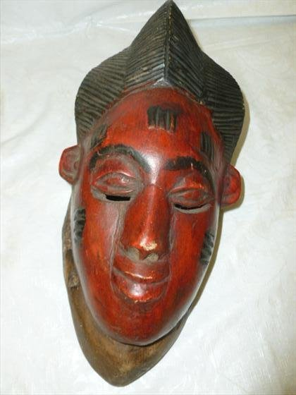 One piece carved African mask