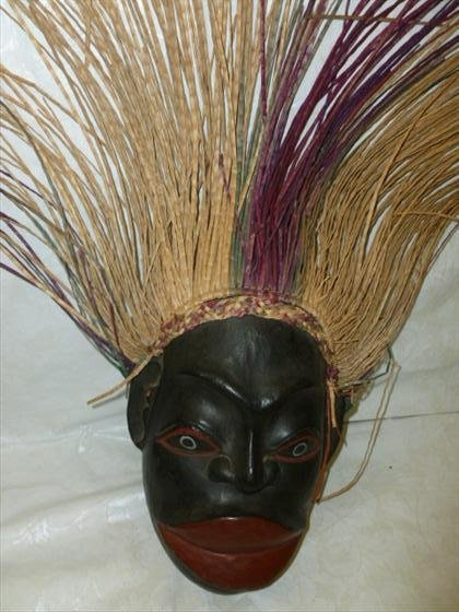 Hand carved wood wall mask with straw hair
