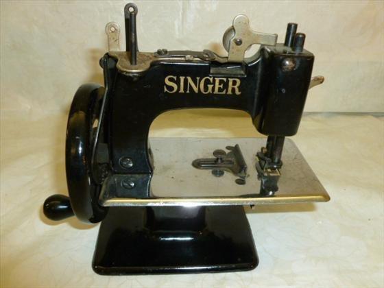 Childs black Singer sewing machine