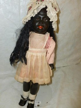 Vintage African American doll in Pink dress